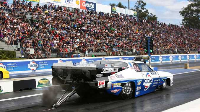 CROWD PLEASER: Winternationals record-breaker John Zappia blasts down the Willowbank Raceway dragstrip during the weekend.