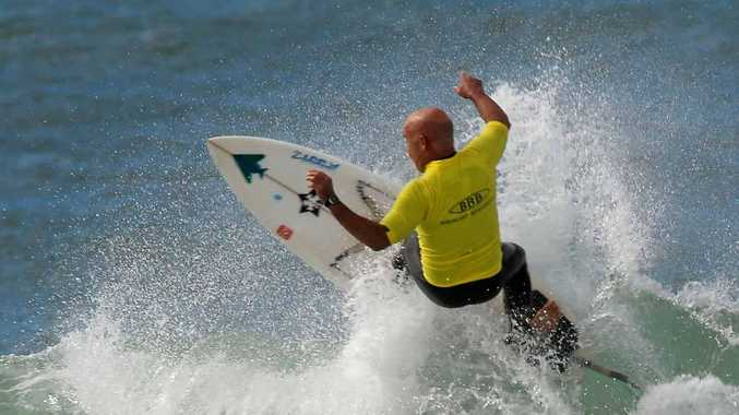 SUPER SKILLS: Nick Pearson does a top and turn during the Legends over-50s third heat at the Ben King Memorial Surf Classic yesterday.