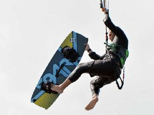 Windy weather helps kite surfer leap 10.6m over wall