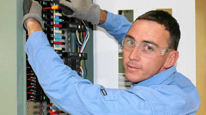CHARGING AHEAD: Electrician Owen Murray is excited to be a finalist for Apprentice of the Year in the Queensland Training Awards. INSET: The Murray family, before Jackie's cancer diagnosis.