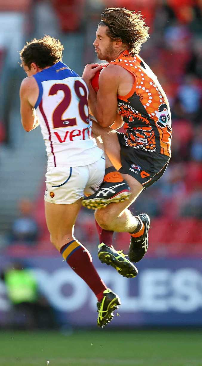 CAPTAIN'S EFFORT: GWS Giants' skipper Callan Ward takes a courageous mark against the Lions at Spotless Stadium.