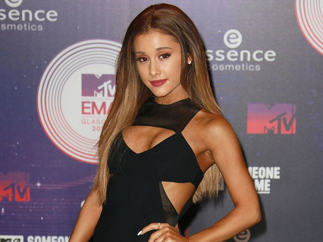 Ariana Grande is officially dating dancer Ricky Alvarez and a friend close to the pop star insists they