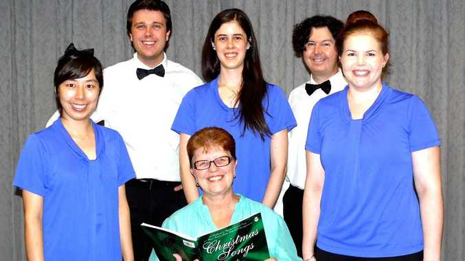 Rockhampton Musical Union Choir conductor Christine Netherwood with choristers Songyi Han, Matthew Dennis, Kate Bungey, Bill Paterson and Lauren Gabriel will present a Christmas concert on Sunday, December 14 2014.