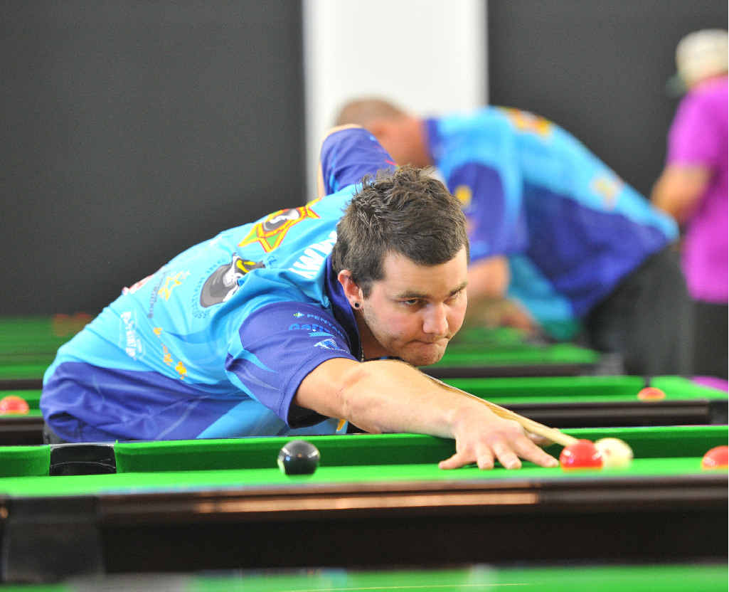 WORKING HARD: Tim Work concentrates on potting a ball in his grand final of the C Grade singles CQ Zone Championships.