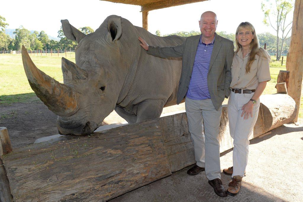 TALKING TOURISM: Terri Irwin and Simon Ambrose with one of Australia Zoo's white rhinos, DJ.