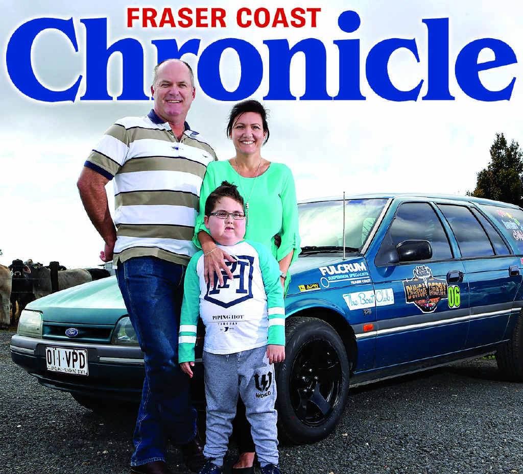 Amanda and Michael Christensen with their son, Cooper in front of their vehicle being entered into the Dunga Derby.