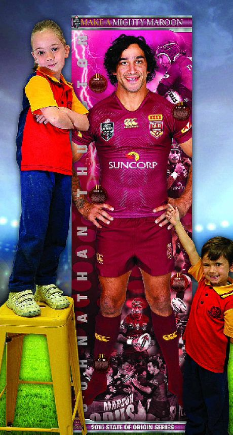 Just like Danika and Zayne Bambling you can get up close to Queensland star Johnathan Thurston by collecting the giant poster pieces which start in the QT from today.