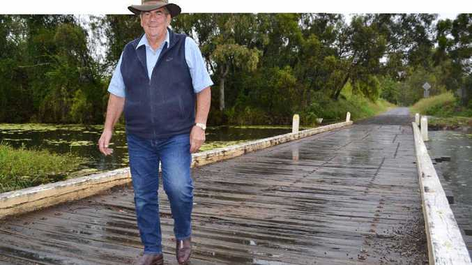 STAYING SOLID: Somerset Mayor Graeme Lehmann at the site of the two Hine Road Bridges that will be replaced with a stone and concrete structure.