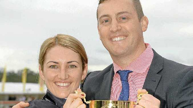 MAJOR REWARD: Last year's Ipswich Cup-winning jockey Tegan Harrison and trainer Tony Gollan savour a special moment in Ipswich. Gollan also shared in the Eye Liner Stakes win.