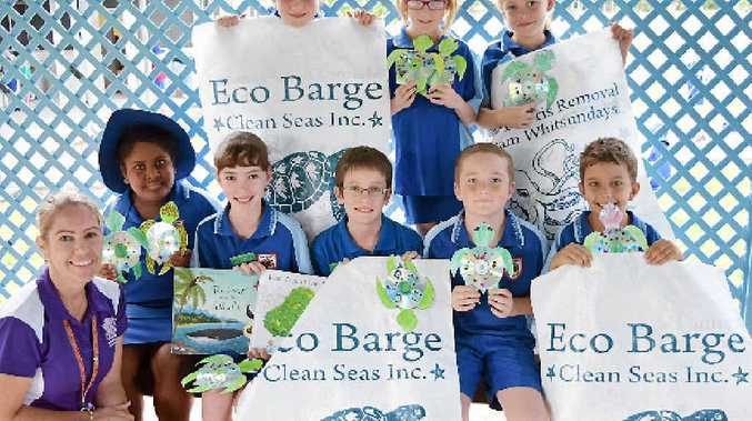 MAKING A DIFFERENCE: Cannonvale State School Grade Three students Indianna Townsend, Airlie Weller, Jade Healey (back), teacher and Reef Guardian co-ordinator Kerri Head, Sureti Rokotovaga, Grade 6 eco ambassadors Lily Arena and Ben Ivers, Oxsen Prosser and Cody Gibbs do their part for World Environment Day on Friday.
