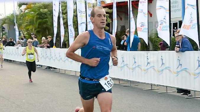 SECOND PLACE: Steve Jackson crosses the line at the Mackay Marina Run half-marathon on Sunday.