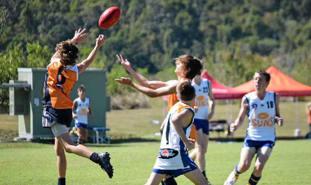 HIGH FLYING: Mitch Healey (left) flies for a mark against Townsville on Saturday at the Whitsunday Sportspark. Mitch was one of three Sea Eagles eventually picked for the CQ team.