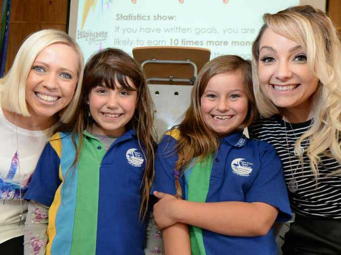 STAY HAPPY: Tresne Middleton and Carly Saunders with Emu Park State School students Angelina Brown and Alexandra Ibbertson are all smiles at Carly and Tresne's happiness and wellbeing presentation at the school last week.