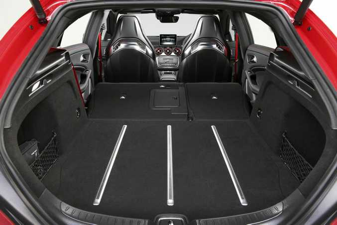 OPENED UP: Rear cargo area shape not as useful as a boxy old traditional wagon's. Prettier though.