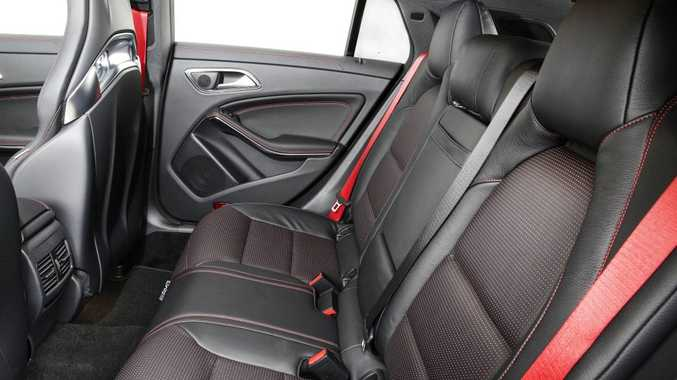 OUT BACK: Rear seats offer a touch more headroom than the CLA four-door coupe, but still a bit claustrophobic back here