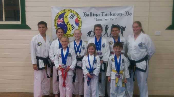 Ballina Taekwondo Australian champions (from left) Marc Bagatan, Eliana Brown, Lily Hogbin, Kate Schaefer, Tilly Brown, Jesse Hogbin, Ethan Bagatan (back), Sam Bagatan and Riki Wood.