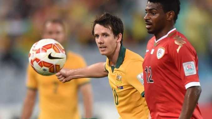 Robbie Kruse of Australia (L) and Ahmed Mubarak of Oman (R) fight for the ball during their Group A football match at the AFC Asian Cup in Sydney on January 13, 2015.