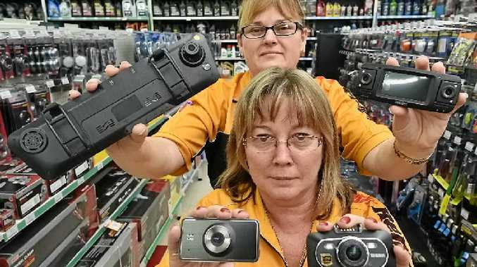 NEW AID: Tracy Miles (front) and Debra Rudd from Repco Hervey Bay with a selection of dashboard cameras on sale to motorists.