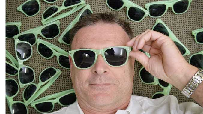 READY FOR A RECORD:Ipswich Turf Club's Brett Kitching now has 5000 sunglasses ready for the Ipswich world record attempt.