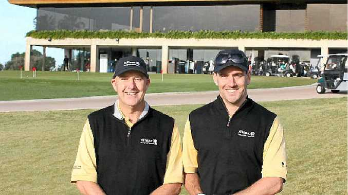 JACKPOT: Brian Chatham (left) and Dustyn Brown, of Forbes Chatham Insurance, won the trip of a lifetime to the British Open at an industry golf day in Sydney.