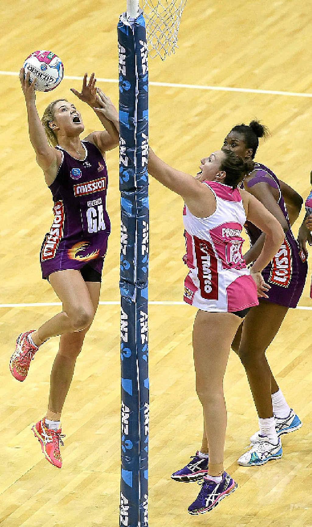 Firebirds' standout Gretel Tippett shows her unorthodox goalshooting style.