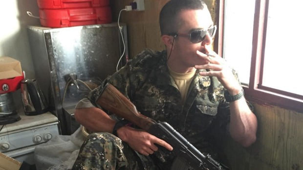 Brisbane man Ashley Dyball, aka Mitchell Scott, is fighting against Islamic State.