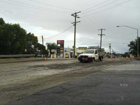 A ute negotiates a pothole in a section of Sugar, Maroochydore, that is currently under roadworks. Photo Stuart Cumming/ Sunshine Coast Daily