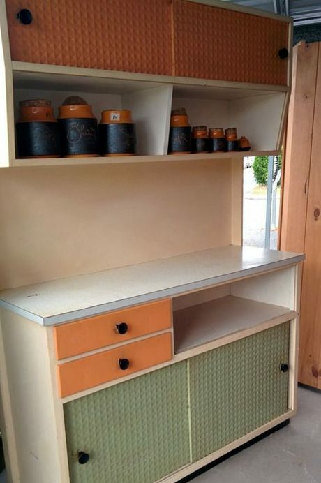 Blue Care's Buy of the Month, a retro dresser for $80, with the canister set priced at $6.
