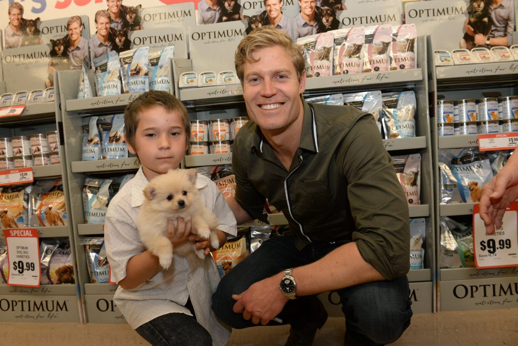 VET IN TOWN: Chayce Petersen and his dog Teddy with Dr Chris Brown at the North Bundaberg IGA. Photo: Mike Knott / NewsMail