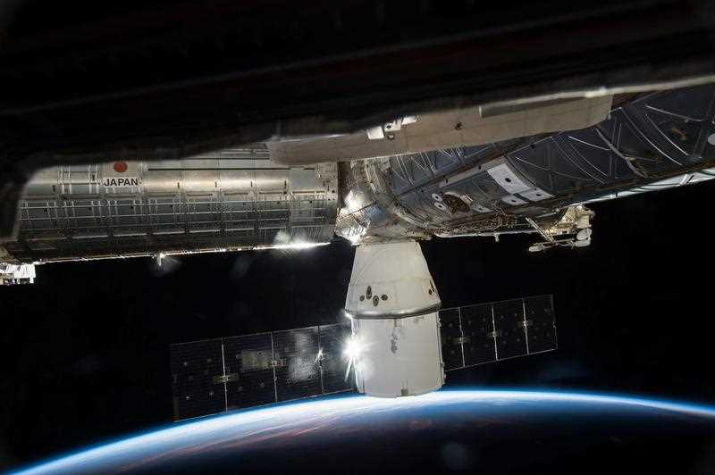 SpaceX's Dragon cargo capsule docked to the Earth-facing port of the Harmony module of the International Space Station (ISS)