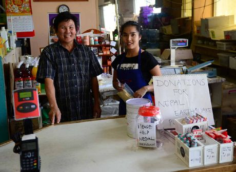 KEEP TO HELP: Food Sing Trading owner Hing Vien, pictured with shop attendant Trinh Le, has put a new charity donation tin on the shop's counter. INSET: CCTV footage of the thief in action.