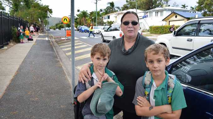 NO PARKS LEFT: Wandal woman Merril Fossey picks up her grandsons Brock, 6, and Jakk, 8, from school. Merril this week spoke out about the parking mayhem at the Glenmore school precinct.