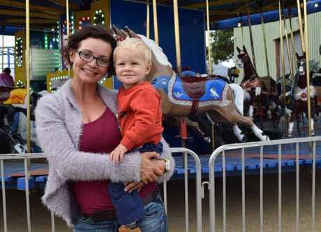 MERRY SHOWGOERS: Tara Duggan with her son Ty Duggan enjoy the final day of the Rockhampton Show 2015.