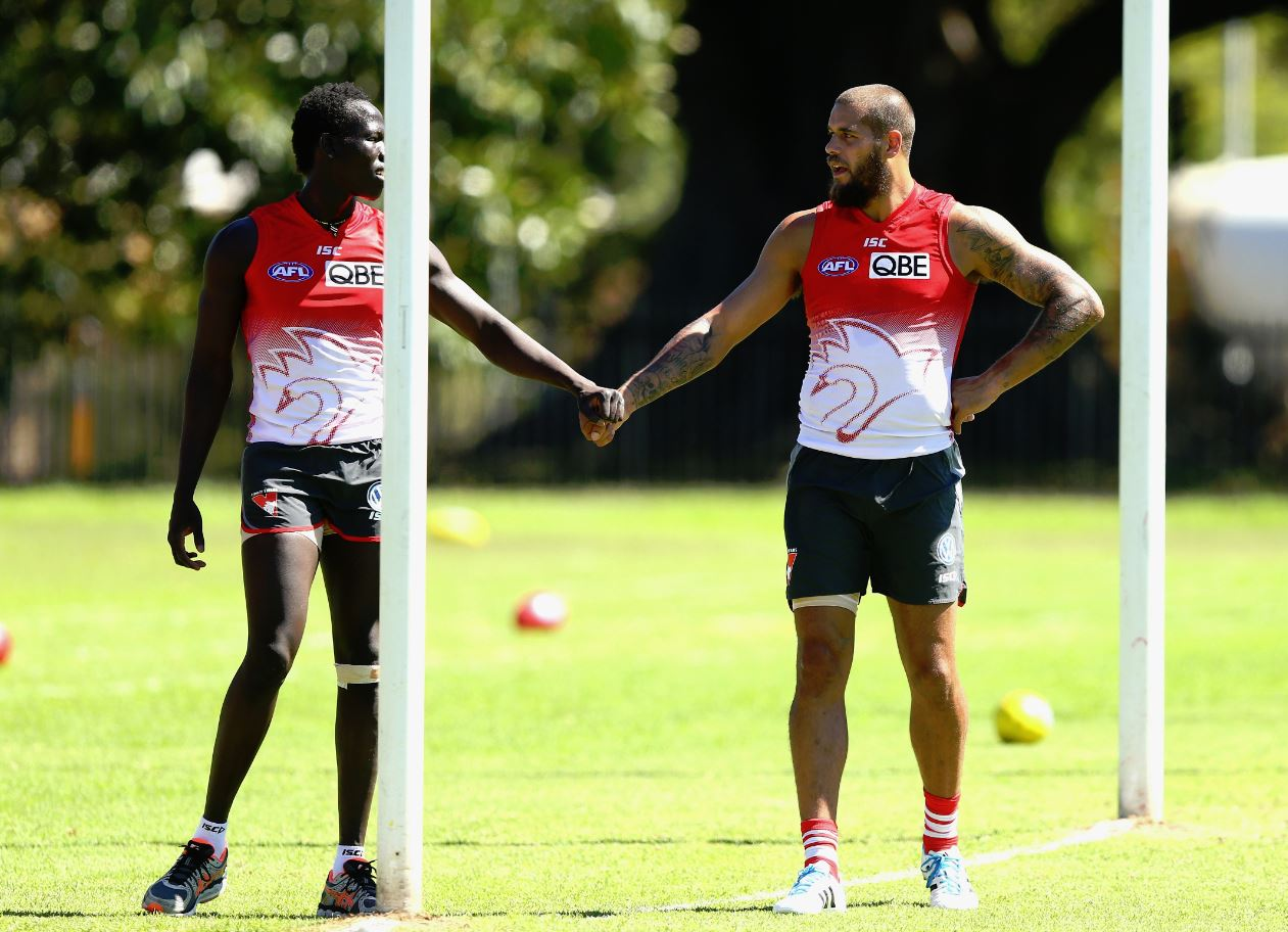 Master and the apprentice ... Aliir Aliir stands next to Lance Franklin during a Swans intraclub hitout