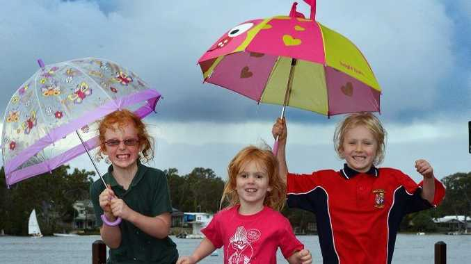 Amy, 8, Erin ,4 and Sally Miller, 6 of Marcus Beach having fun despite the gloomy weather.