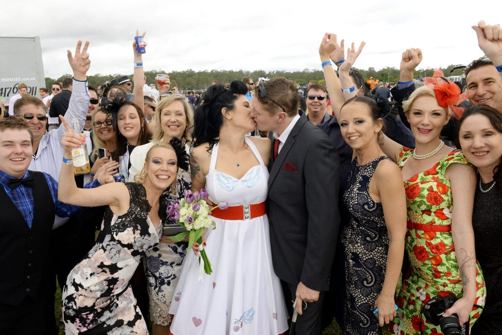 WEDDING BELLS: Friends and family gather to celebrate the wedding of Jodie Ellerton and Brendon Bell at the Ipswich Cup.