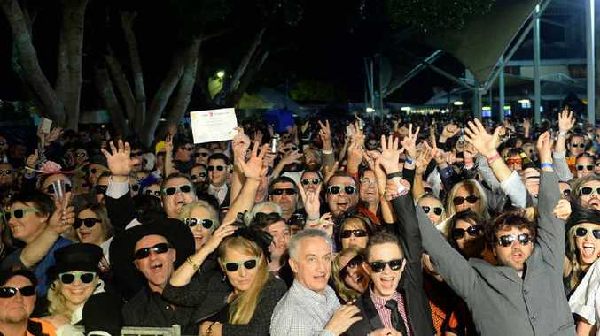 BRIGHT MOMENT: There's always one in a crowd, and fortunately there was only one not wearing sunglasses as Ipswich smashed the world record.