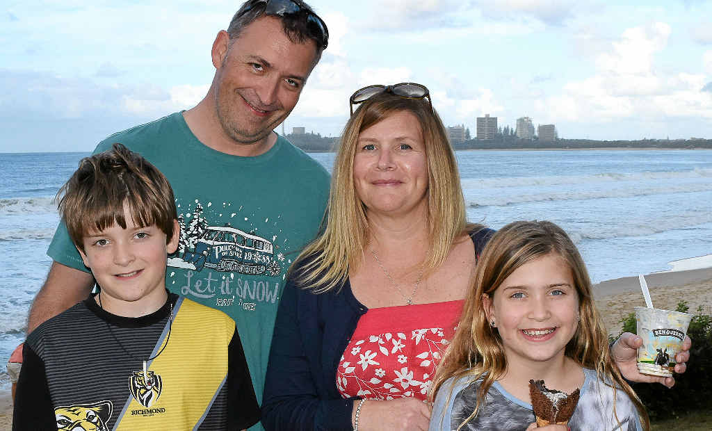 ADAPTING WELL: Josh, 10, and Emily, 8, with Louise and Brett Brook still make time to visit the beach despite the winter temperatures.