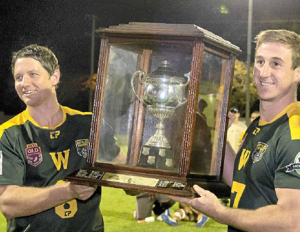 VICTORIOUS: Wattles' Aaron Scheid (left) and Matt Duggan lift the Madsen-Rasmussen Trophy after their win against Gatton in TRL at Clive Berghofer Stadium.