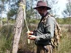 Mark Robinson from North Coast Local Land Services records project boundaries for bush regeneration at Urunga Lagoon.