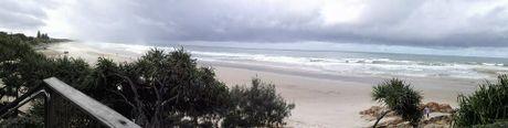 Rain over Coolum Beach taken by reader Damo T Orrens.
