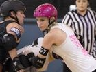 ON THE MOVE: Sarah Grinham (pink helmet) in action during the mixed roller derby bout at St Mary's College.