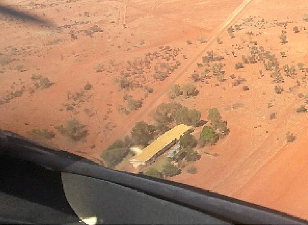 OUTBACK MEDICINE: Royal Flying Doctor Service flying into Jundah – the hospital is left of shot, golf course on the right and (inset) pilot Ross Thomas, doctor Jon Outridge and nurse Courtney Bylett.