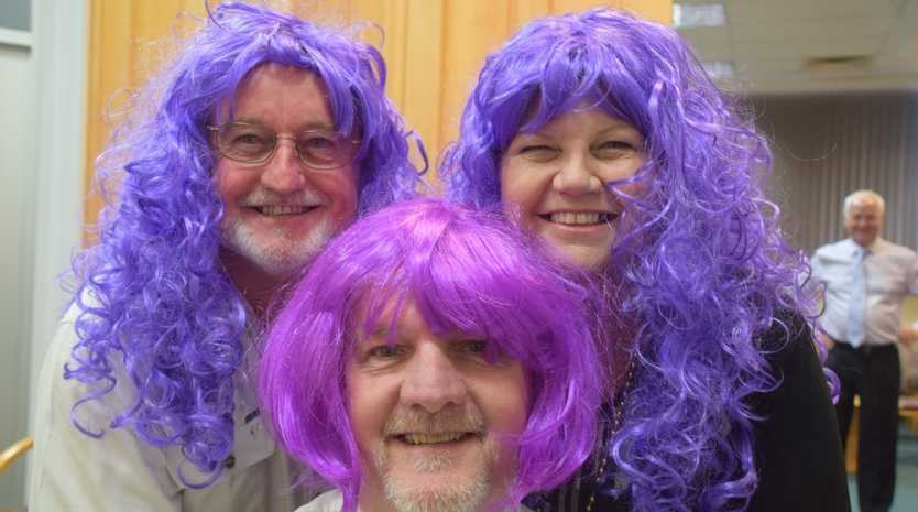 PURPLE HAZE: Councillors McDonald, Brushe and Hansen aren't afraid to show their colours in support of Relay For Life. Photo Helen Spelitis / Gladstone Observer