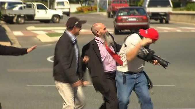 A still from the scuffle between Ian Antonio and a Townsville photographer today.