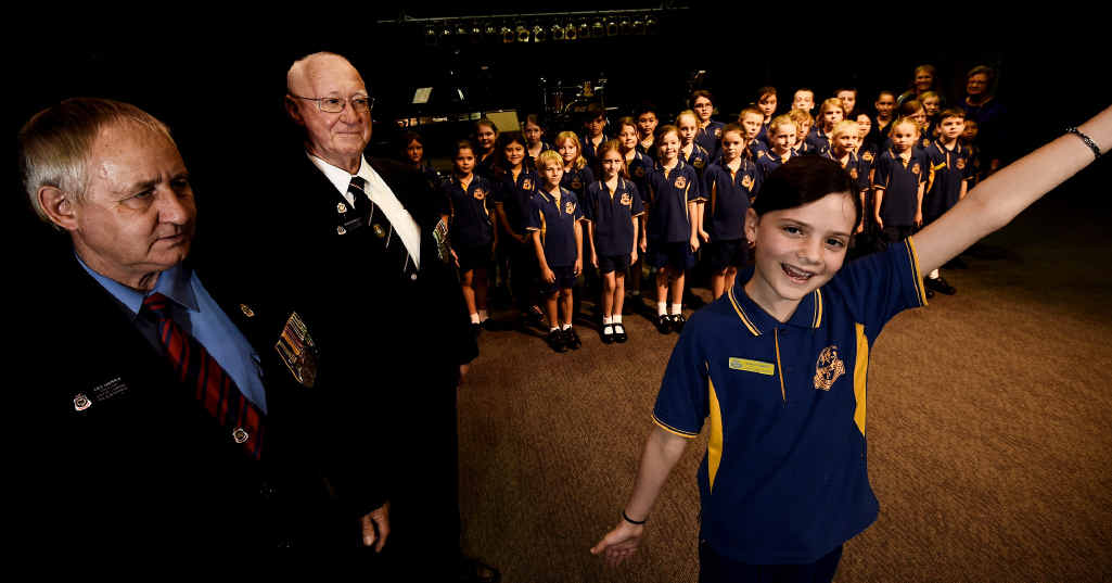 ALL TOGETHER NOW: Member Daisi Thompson, 11, leading the Lismore Public School senior choir in O Valiant Heart at Southern Cross University's recording studio, listened to by Lismore RSL Sub Branch members.