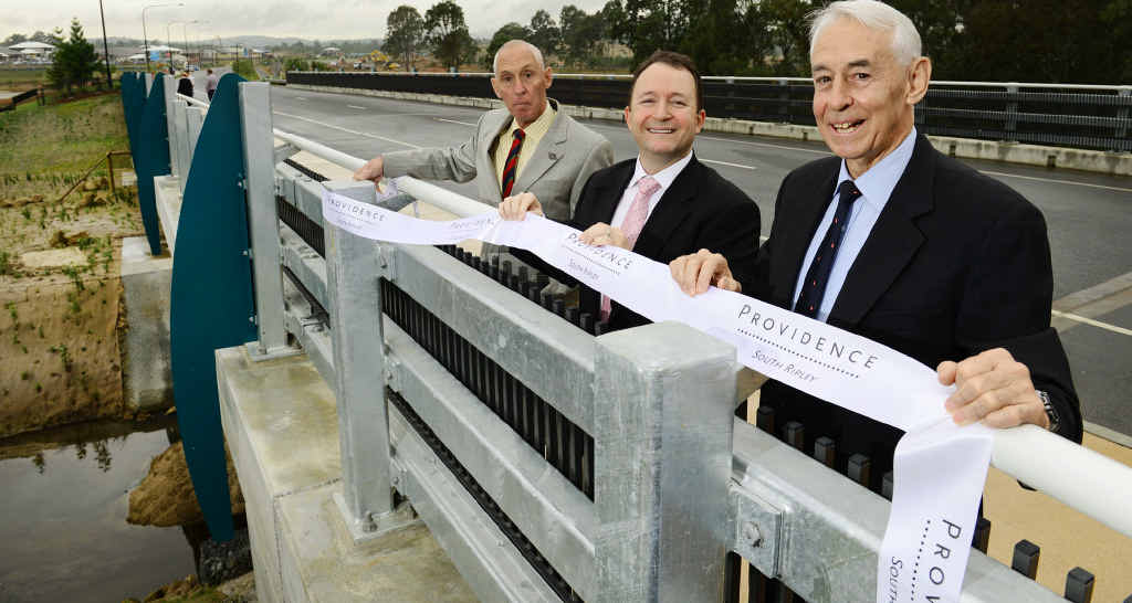 IPSWICH HISTORY: Great grandsons of James Ivory, Derek Nixon-Smith (right) and Rod Nixon-Smith (left) with developer Adam Shephard (centre) from Amex Corporation at the opening of the James Ivory Bridge in Providence, South Ripley.