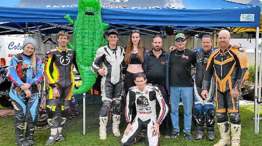 FIERCE RACERS: Georgia Murray, Aaron Barr, Brett McLiesh, NSW resident Casey, Mungo McMurtrie, Marty Taylor, Craig McDermott, Andrew Auld and Andy McLiesh (front) in Newcastle for the Australian Supermoto Championships.