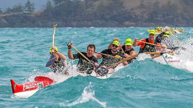 BATTLING THE ELEMENTS: Hamilton Island Master Men in the weekend's Clash of the Paddles. Photo: Adam Starr