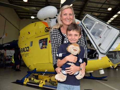 SURVIVOR: Former RACQ CareFlight patient Bailey Teed, 8, and his mother Michelle Bloomer inspect the organisation's Sunshine Coast Airport base.